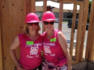 Kerry and Jodi of WWM Financial volunteering at a Habitat for Humanity  project.